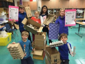 Students holding cardboard